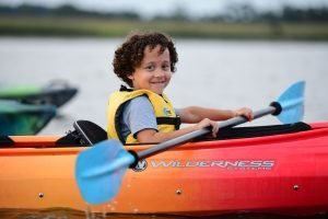 close up of young boy on kayak